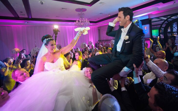 The couple was lifted up in the air by their family and friends for a traditional hora dance.