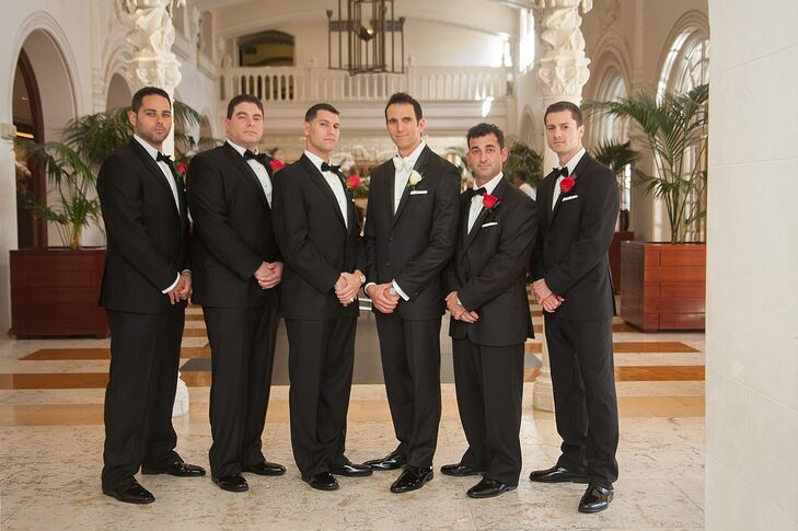 The groomsmen wore custom tailored black tuxedos with black vests and bow ties from the Tux Shop in Palm Beach Gardens, Florida.