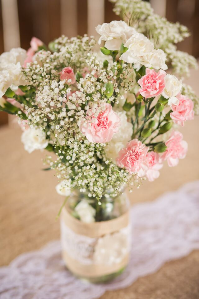 Pink carnation and baby s breath centerpieces