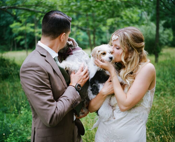 One of the big selling points about Woolverton Inn in Stockton, New Jersey, was that Gina and Mike could include their dogs in the celebration. The couple love their pets and included both Maverick Jay, left, and Elsie Kay in the ceremony as their ring bearer and flower girl. Maverick Jay even wore a polka-dot bow tie in maroon to fit their color scheme.