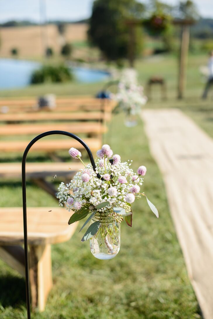 Hanging Mason Jars With Pink Thistles And Babys Breath As Aisle Decor