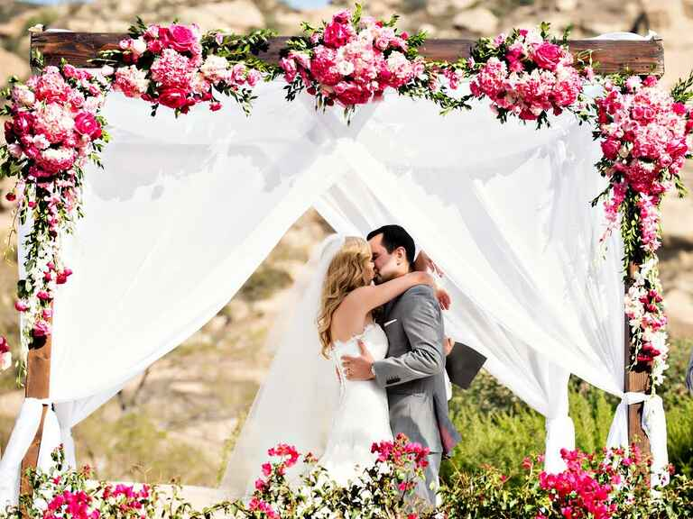 Couple kiss at wedding altar