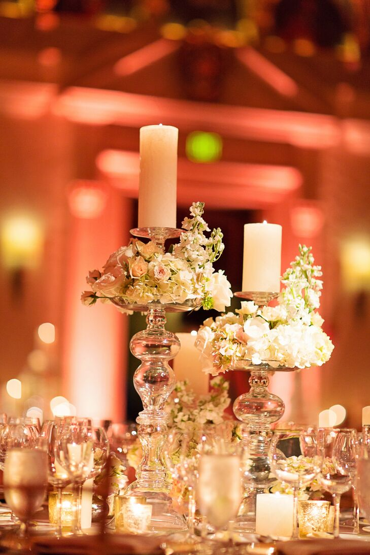 Clear glass candelabra centerpieces with hydrangeas