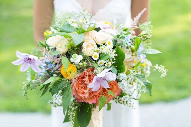 Natalia's wild, textured bouquet featured garden roses, astilbe, Queen Anne's lace, scabiosa and ranunculuses.
