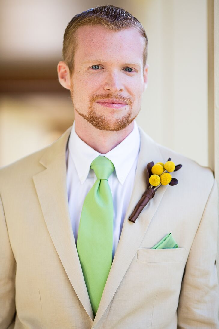Darryn wore a khaki suit with a bright green tie and matching pocket square. He also wore a boutonniere with craspedia.