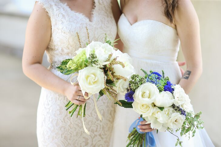 Aside from a request for neutral flowers, Elana and Jamie gave Petit Jardin en Ville free rein to design these bouquets. The result was nothing short of classic. White lisianthus and greenery filled both displays with a few distinctions. Elana's arrangement was a little more natural with green hydrangeas and a champagne ribbon wrap while Jamie carried small blue flowers in her blue ribbon-wrapped bouquet for an extra pop of color.
