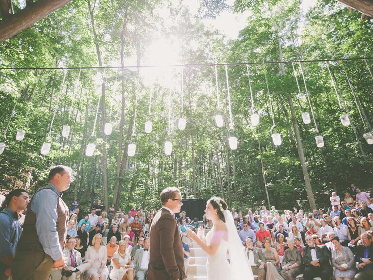 Hanging lanterns at outdoor ceremony