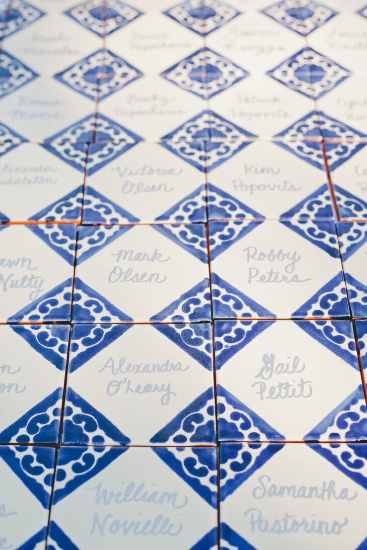 In lieu of traditional paper place cards, the couple nodded to Ojai's Spanish influences with their ceramic tile place markers.