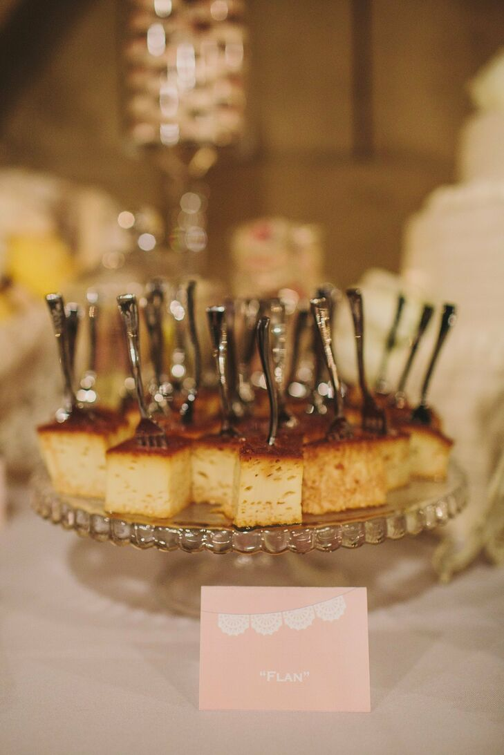 Individual silver forks were placed in personal squares of flan for dessert.
