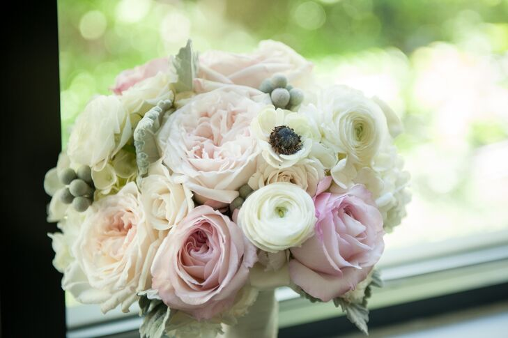 Katleyn's pink and ivory bouquet included garden roses, ranunculus and anemone.