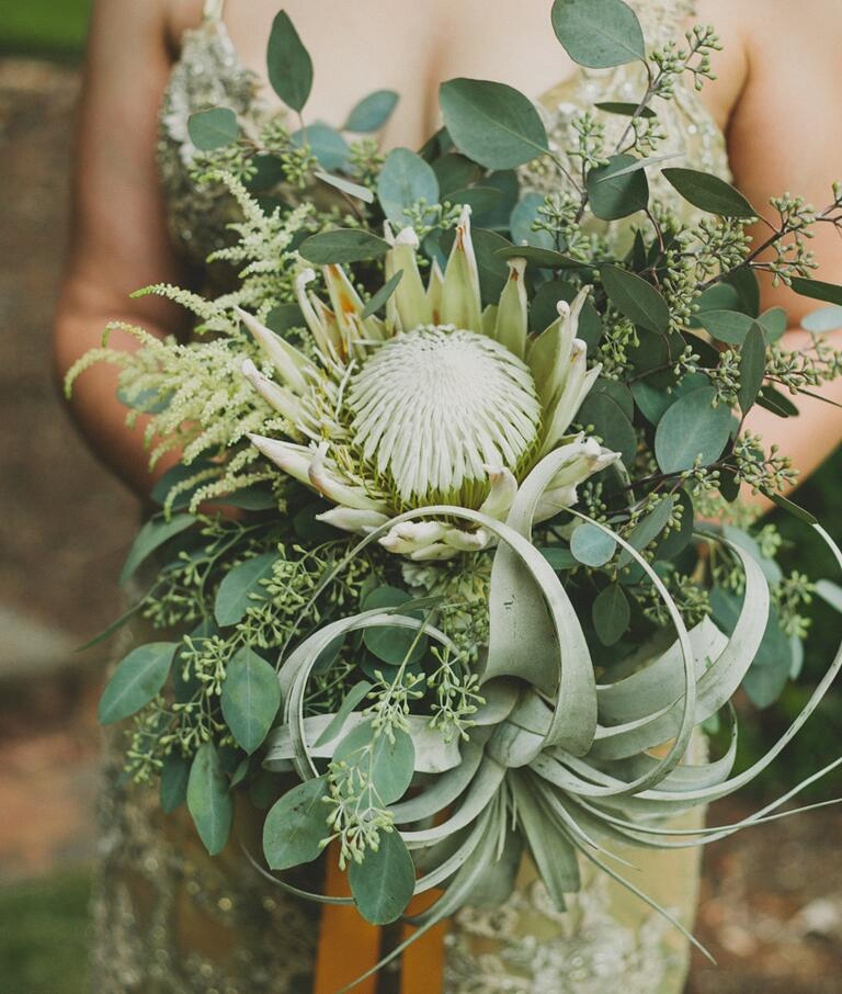 Green bridesmaid bouquet with king protea, air plants and seed eucalyptus