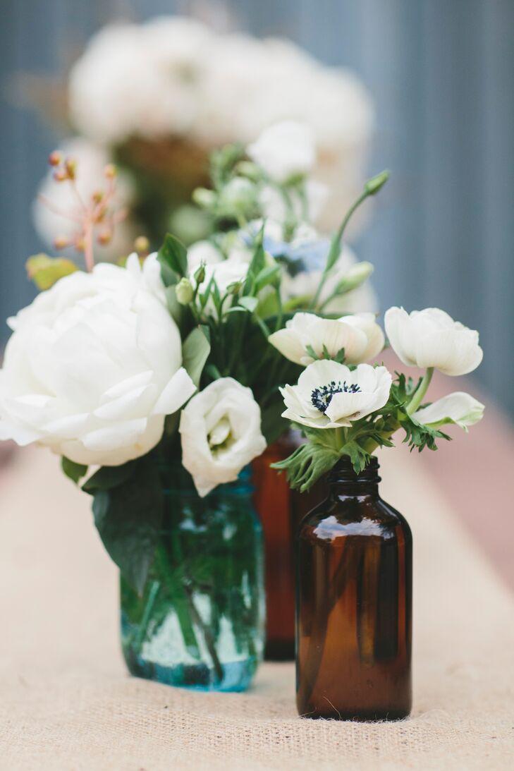 White flowers in vintage medicine jars mightylinksfo