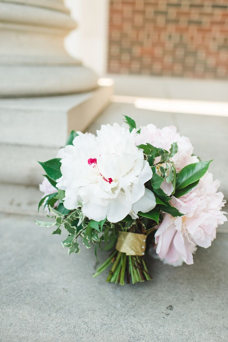 Melissa's bouquet of fresh, fluffy peonies in soft pink and white was undeniably romantic. Pops of leafy greens added definition to the textured arrangement.