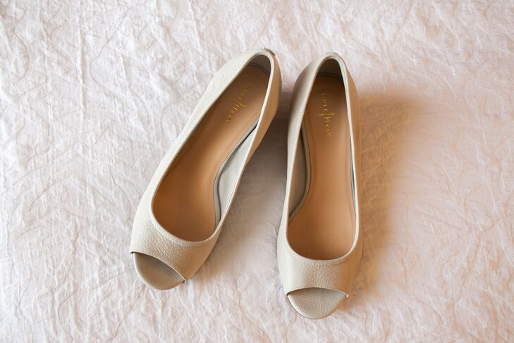 The bride wore a pair of beige flats with an open toed style, designed by Cole Haan.