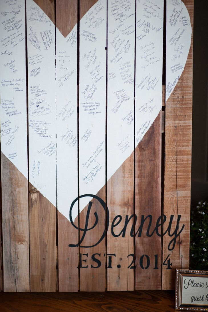 """I wanted our guest book to be unique and continue the rustic style, so I made our guest book from an old wooden pallet,"" the bride says. She painted a heart and the wedding date, and asked guests to sign the board."