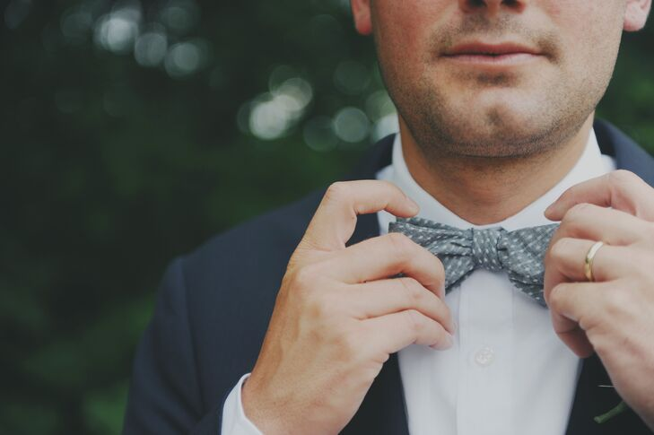 "The bride and groom let each groomsmen pick any bow tie of their choice to pair with leather suspenders. ""Our best man even wore a wooden one!"" the bride says."