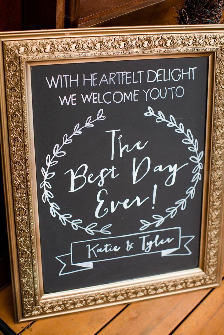 An antique framed chalkboard welcomed guests to the couple's wedding.