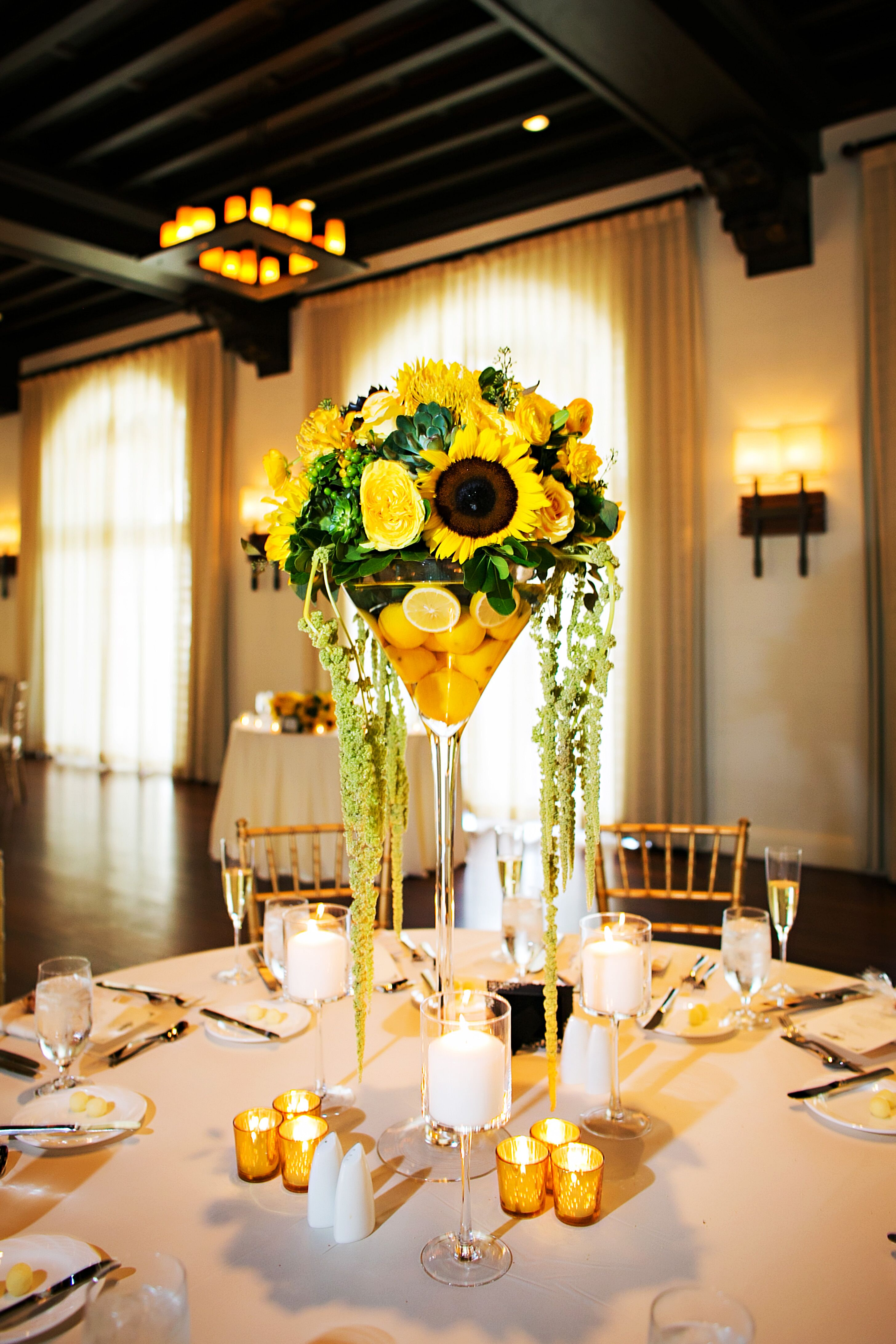 Bright lemon and sunflower reception centerpieces