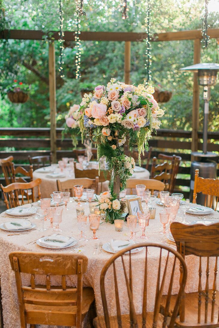Lotus and Lily Floral Design brought Ashley and Johnathan's romantic vision to life with lush arrangements of pastel roses, hydrangeas, peonies, daisies, sweet peas, cascading amaranths and ivy arranged artfully atop bronze candelabras.