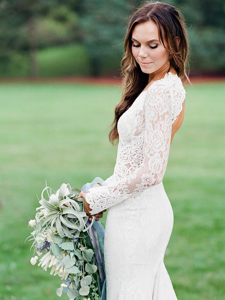 Long sleeved lace wedding dress by Berta Bridal