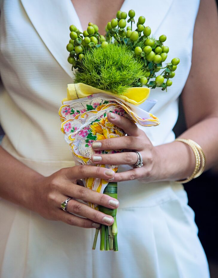"The bridesmaids carried small, green bouquets made of triclinium and green hypericum. ""I wanted them to carry small bouquets that would blend in with the surroundings and wouldn't distract from my dress or the elegance of their jumpsuits,"" the bride says."