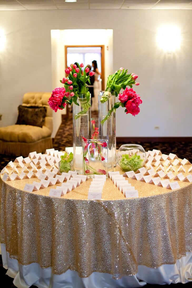 Gold Glitter Escort Table with Bright Pink and Green Centerpiece