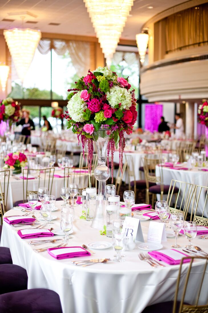 Teresa and Ryan had both tall and short centerpieces with bright pink and green arrangements of roses and hydrangeas, as well as some orchids, ranunculus, tulips, and calla lilies. Bright pink napkins added a pop of color to the white linens. In lieu of favors, cards indicated donations made to the American Liver Foundation and the Make-A-Wish Foundation of Illinois.