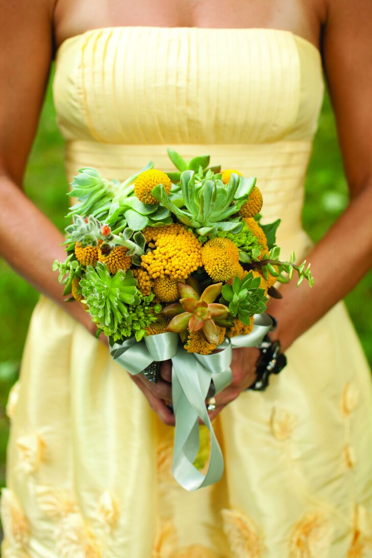 Yellow and green bouquets of succulents and craspedia matched the girls' dresses.