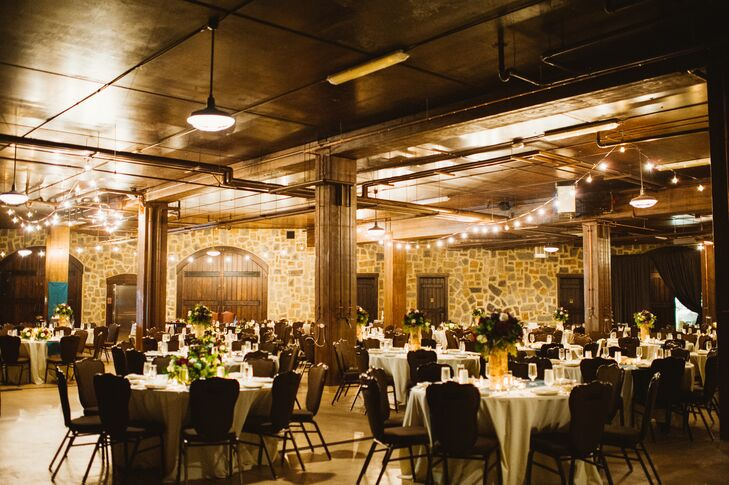 Inside the barrel room, guests sat at round white dining tables draped with teal runners. The wood and stone interior contributed to the overall rustic vibe, with a touch of elegance added through string lights draped from the ceiling.