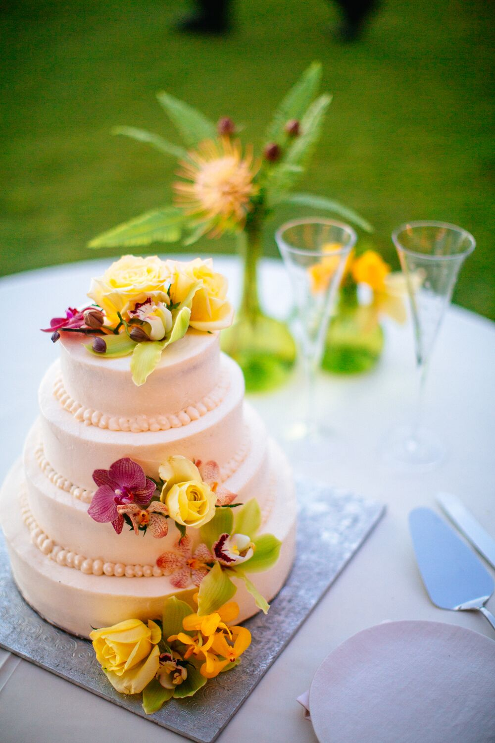 White Wedding Cake With Tropical Flowers