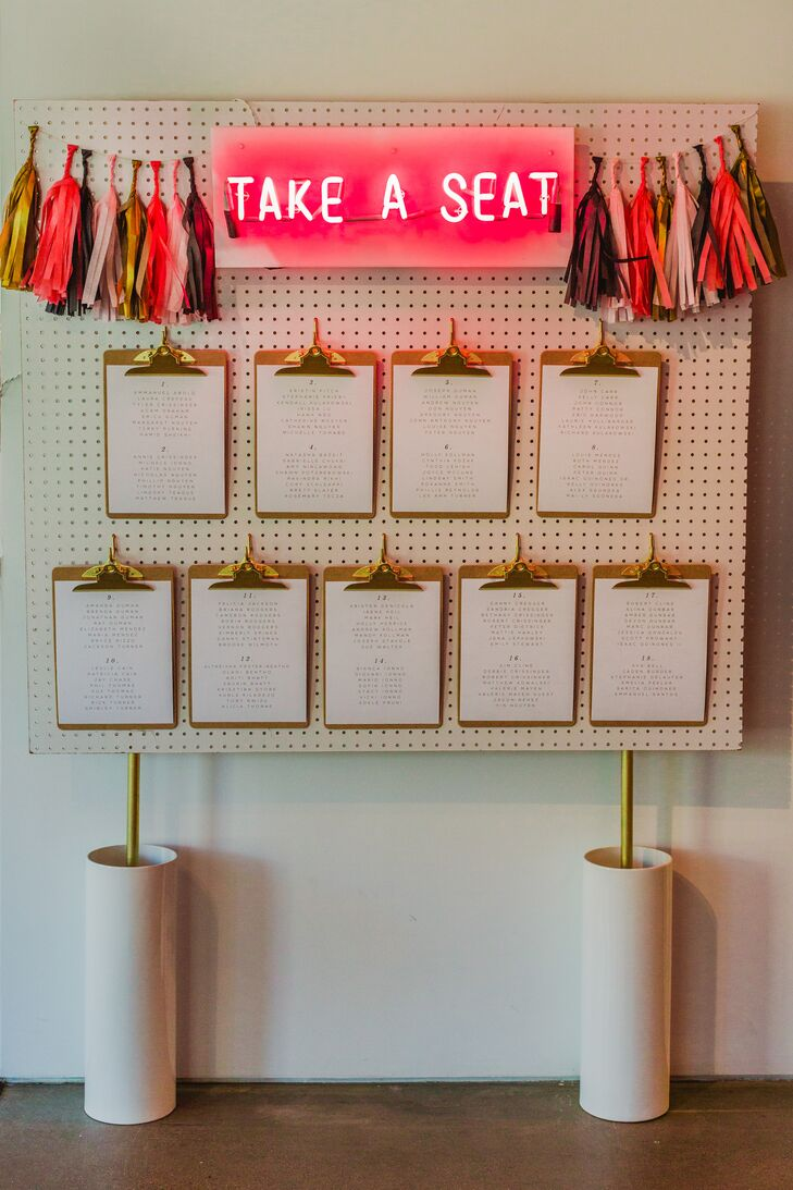 """Amy [Modernly Events] coined the phrase ""TAKE A SEAT"" as the title, which I thought was a perfect reflection of Kate Spade's playful quotes,"" says Shawn. ""Lists of tables with the guests names were then attached to the clipboards, and those were hung on the pegboard."""