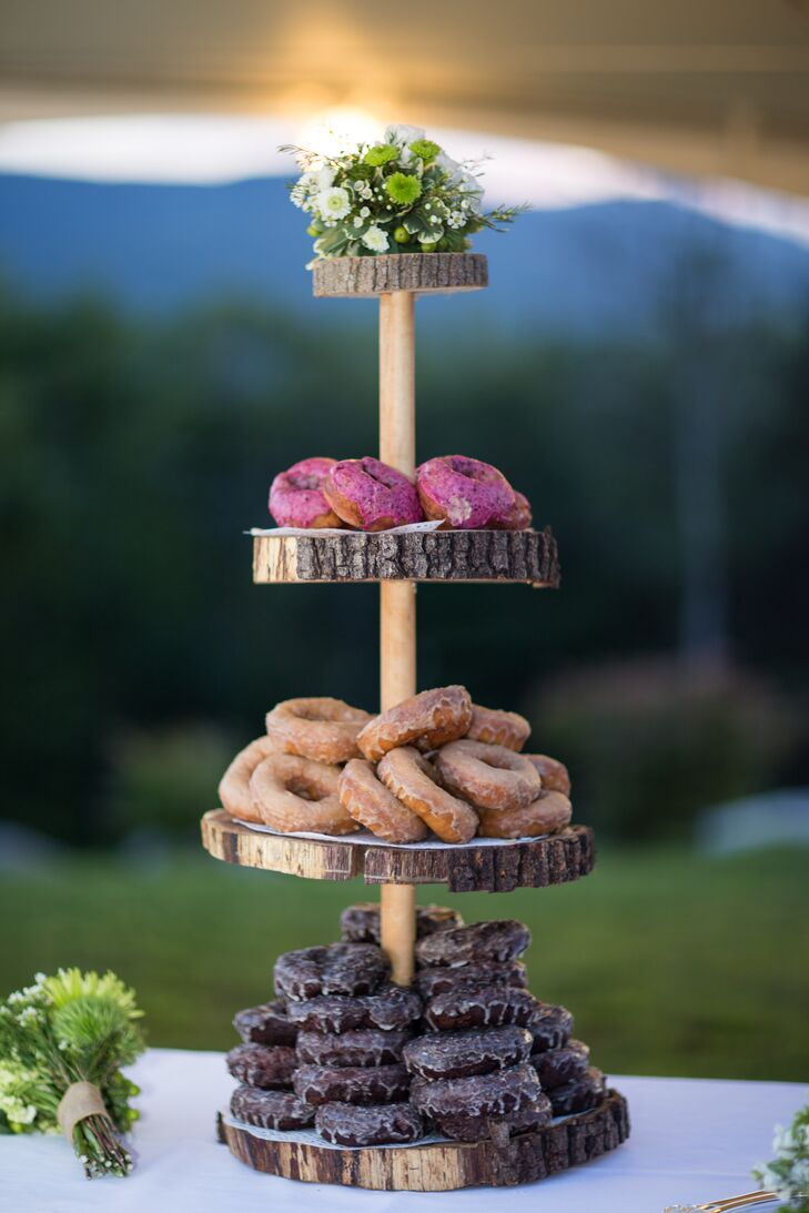 In lieu of a traditional wedding cake, everyone enjoyed doughnuts displayed on a stand made by April's father.