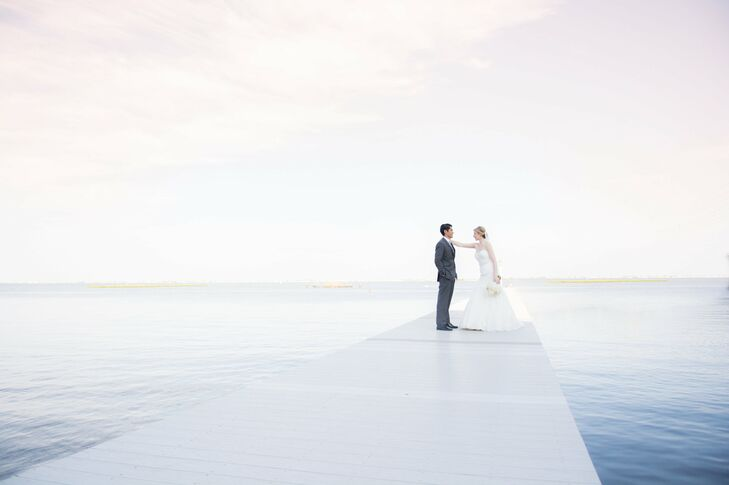 The couple posed for first look photos on the docks at the Mallard Island Yacht Club, surrounded by deep blue, serene water.