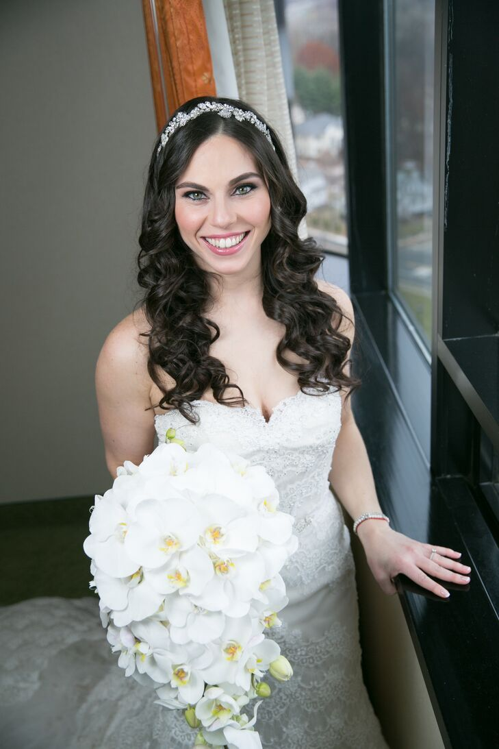 Although Rita chose pink, green and white flowers for her reception florals, she walked down the aisle carrying an all-white floral bridal bouquet.