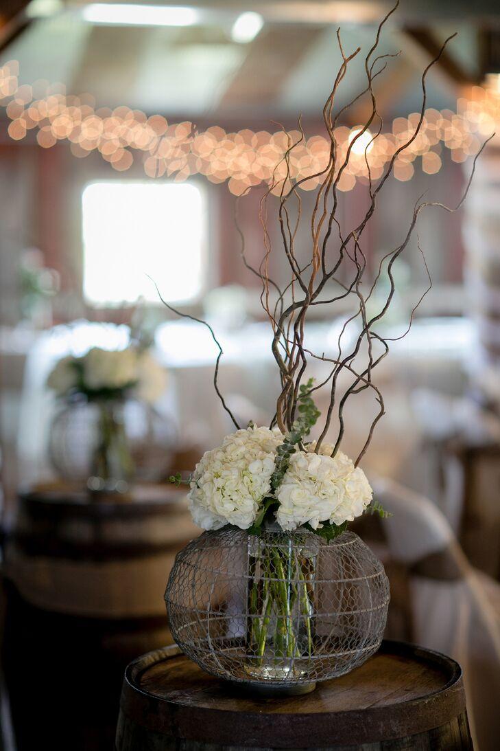 White hydrangea centerpiece in wire basket