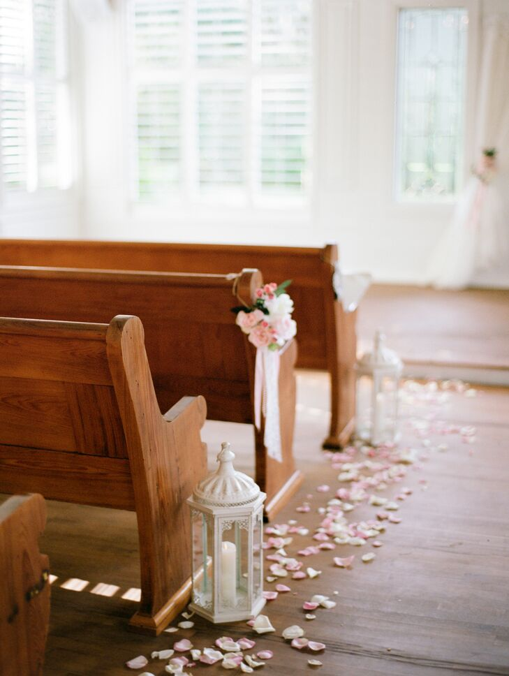 The chapel aisle was decorated simply, with large ivory lanterns, candles and pink flowers gathered with ribbon and pearls.