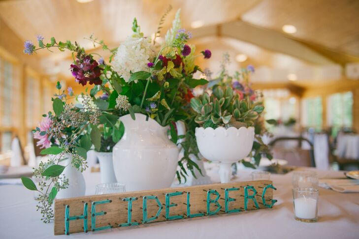 Milk Glass Vases With Colorful Flower Arrangements And Diy Table Names