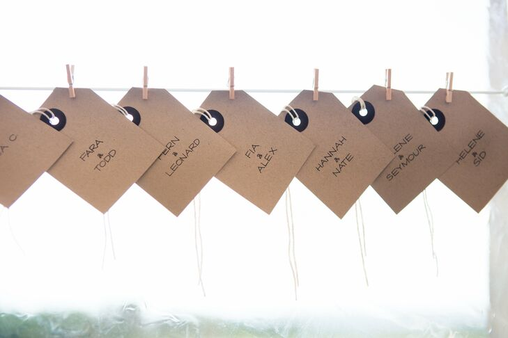 Escort cards were made of craft paper and hung with wooden close pins from white string. Guests were assigned to tables but were free to sit where they pleased.