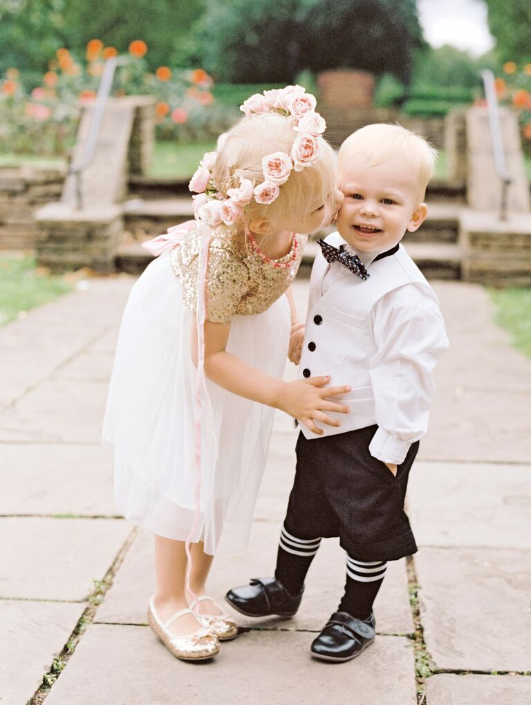 Flower girl and ring bearer dressed in formalwear