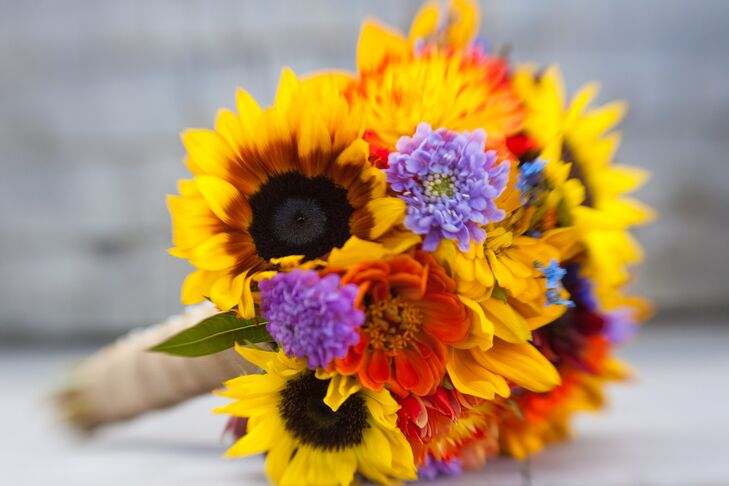 The bridesmaids all carried bright yellow bouquets, a perfect complement to the summer season.