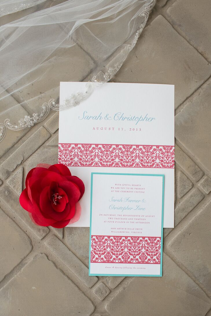 The white wedding invitations had a red patterned stripe going through the middle and was printed in teal text.
