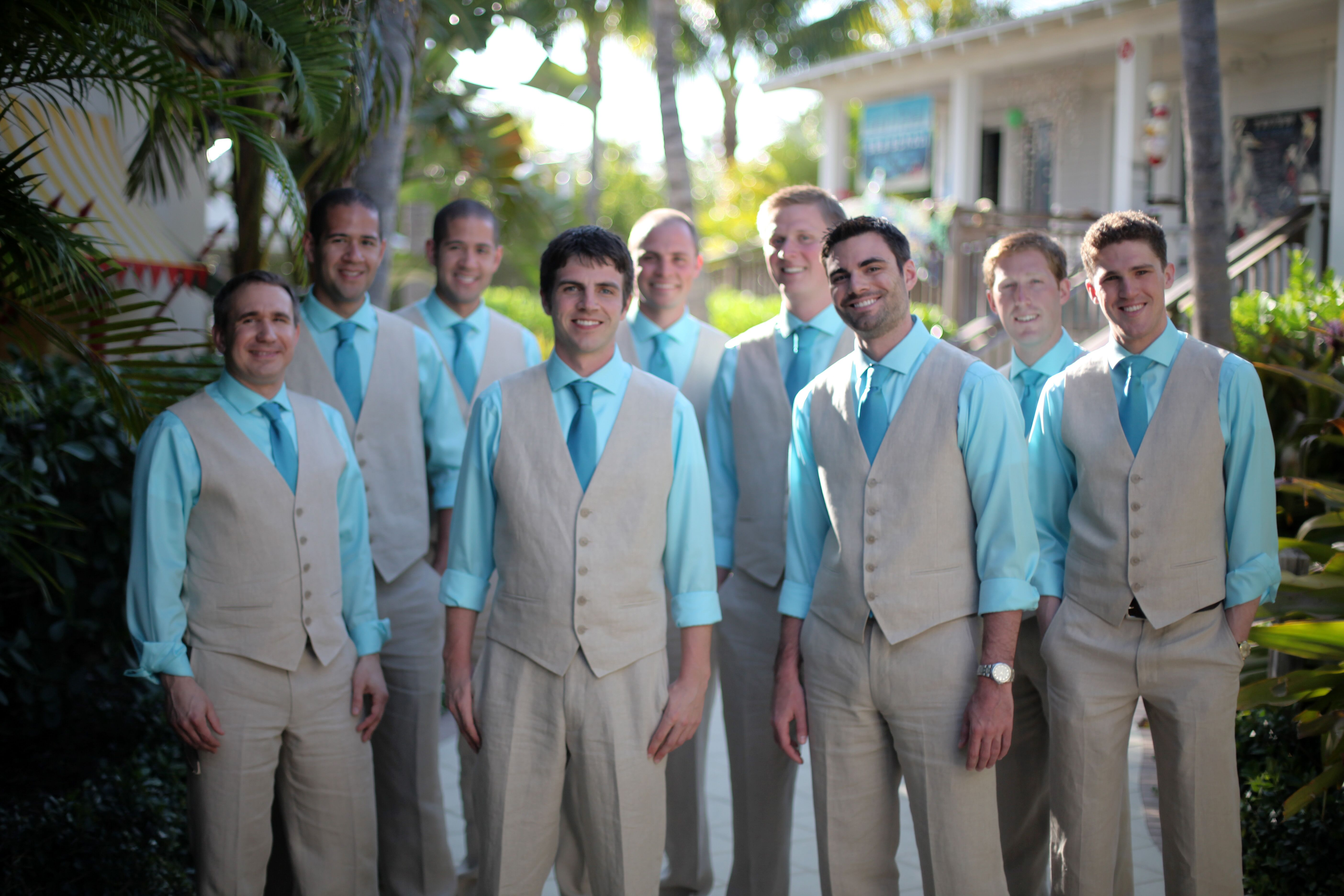 Tan Vests and Pants With Blue Shirts and Ties