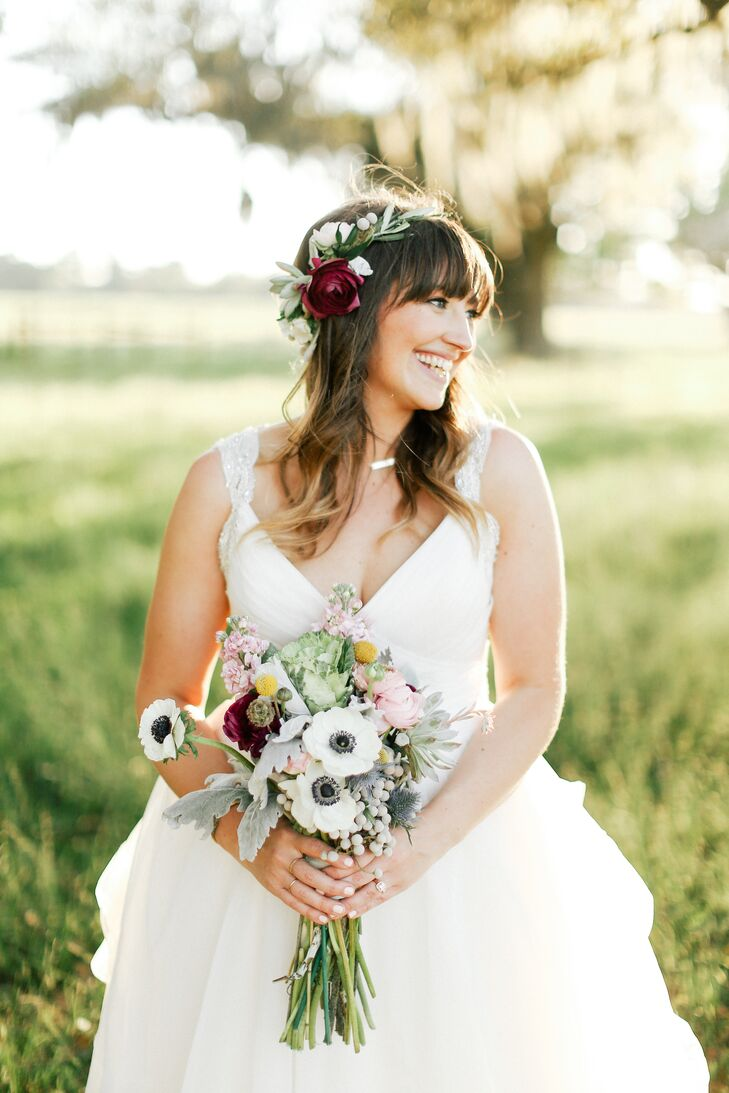 "It was Sarah's dream to wear a flower crown at her wedding. But the morning of the wedding, she ran out of time trying to complete DIY projects. Luckily, her sister and best friend got to work and pulled together burgundy ranunculus, green succulents, white anemones and olive branches to create the boho masterpiece. ""It turned out better than I could have hoped,"" Sarah says. ""At first I was worried it wouldn't go with my dress, but then I reminded myself that it was my day, I was marrying my best friend, and I could do what made me happiest."""