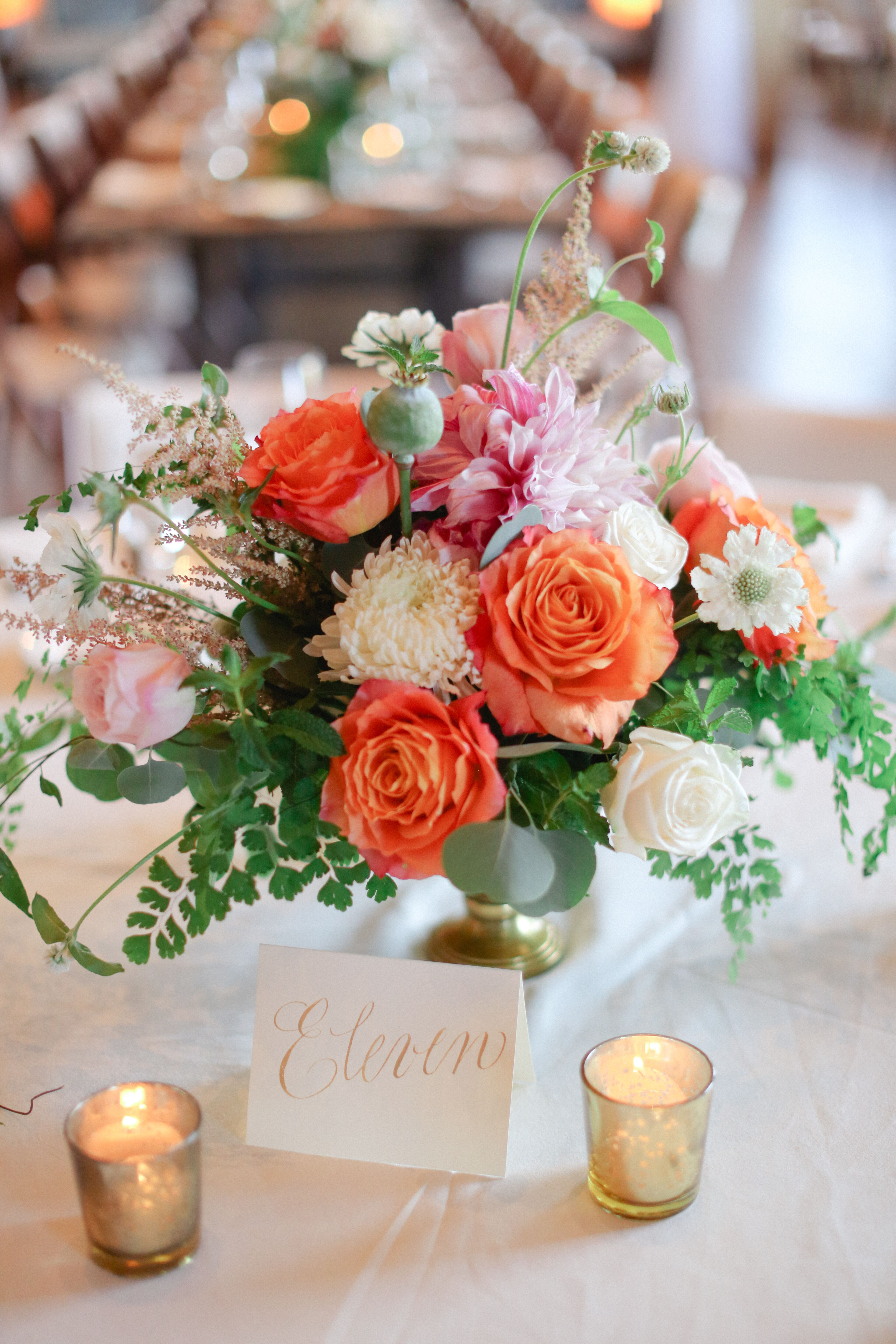 low ivory and coral garden rose and fern centerpiece