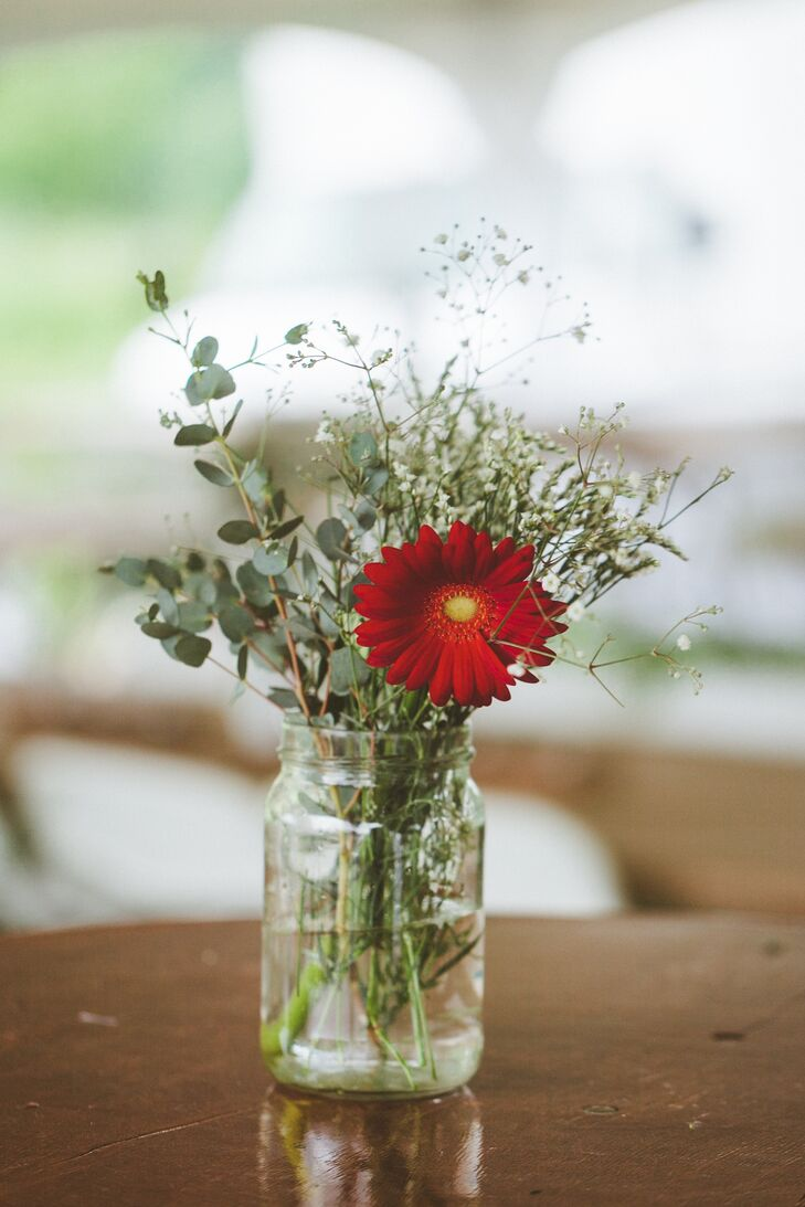 Red gerbera daisy and baby s breath centerpiece