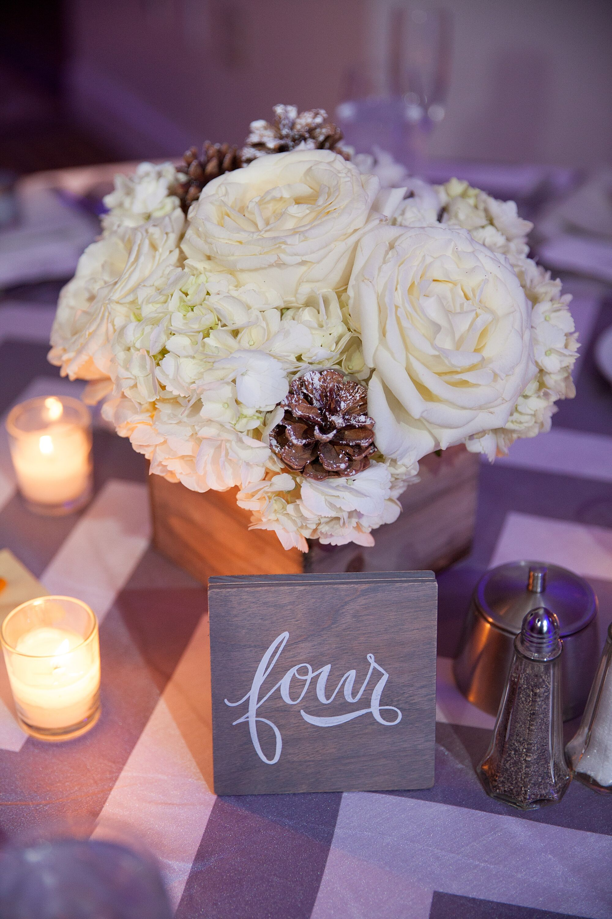 White centerpieces and silver chevron table linens