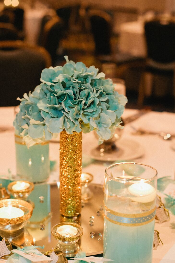 Willie's mother created all the centerpieces for the reception at Minneapolis Marriott City Center in Minneapolis, Minnesota. She found fabric flowers at Michaels and spray-painted them mint to ensure the color matched. All the mirrors were provided by the venue, and added dimension to the room.
