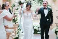 Five months before their wedding, Rubie	Flores and Ryan Olivarez decided to turn their family trip to Rome into a destination wedding at the elegant V