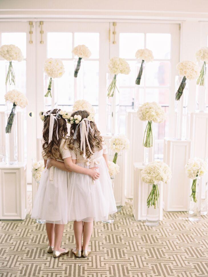 White Flowers In Glass Pillar Vases