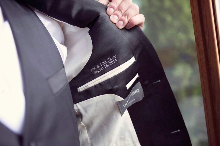 The groom wore a three-piece Indochino suit that he had custom embroidered with the wedding date. He also gave each of the groomsmen gift certificates to purchase their own two-piece suits, which they were able to customize (and keep!) to their own individual style.